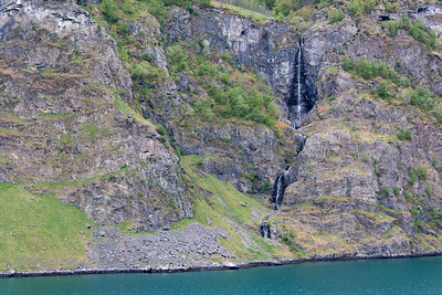 Waterfall on shore of the Aurlandsfjord in Norway