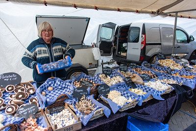 Woman selling mushrooms in Amsterdam.