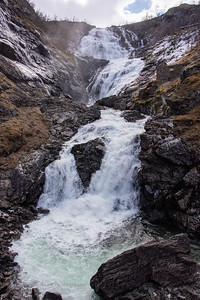 Waterfall at Flåm Railway train stop in Myrdal, Norway.