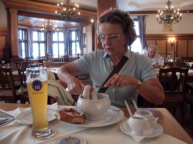 Mom enjoying a pair of Weisswurst at the Hofbraeuhaus, Munich, Germany