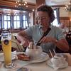 Mom enjoying a pair of Weisswurst at the Hofbraeuhaus, Munich, Germany