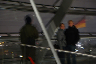 A very blurry shot of Michal's back, Saskia, and Thomas at the top of the parliament dome.