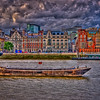 A boat sits in the middle of the Thames River in London, England. Grunge style HDR inspired by Sasha!