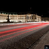 Long exposure shot of traffic passing by in front of Place de la Bourse.