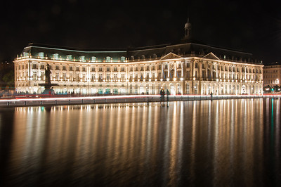 The Miroir d'eau in the evening in Bordeaux, France. I dragged Sasha back for some photos with my tripod of the Miroir d'eau. I really like the way the wind blurred the relfection in the water.