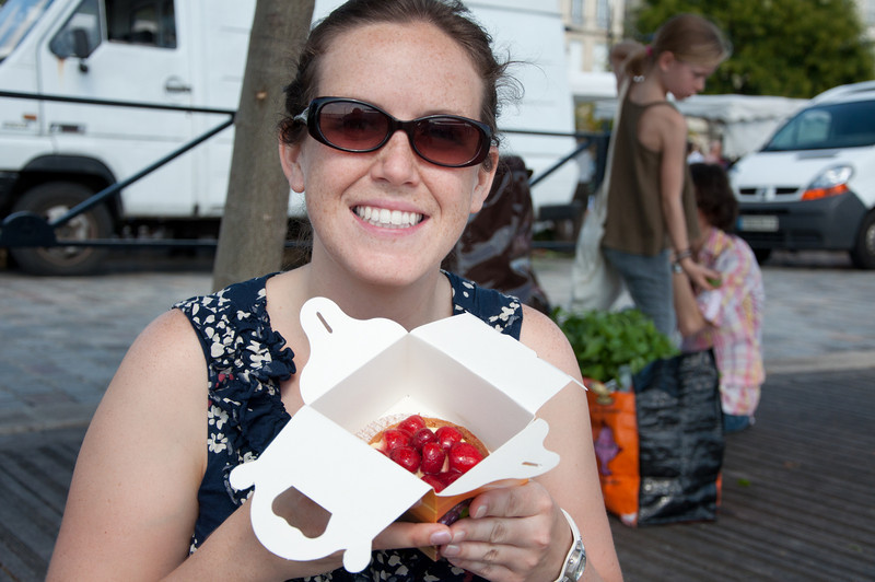 Almost everything was closed on Sunday, but we found a street market by the water where we got some good pastries and grapes. Sasha showing off the strawberry tart that we searched all over Europe for.