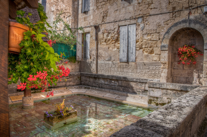 Walking around St. Emilion, I spotted this courtyard filled with a small pool.