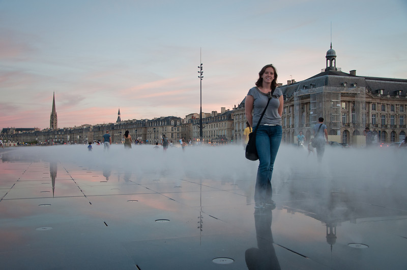 Sasha in front of Miroir d'eau in Bordeaux, France.