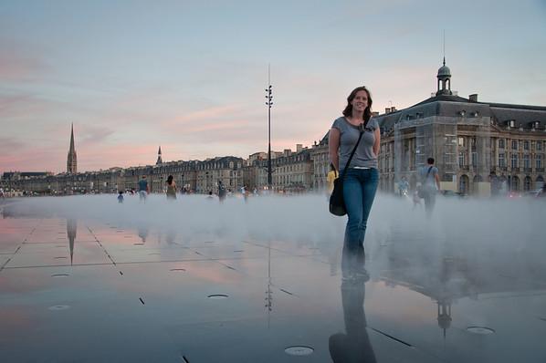 Sasha in front of Miroir d'eau in Bordeaux, France.