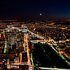 A view of Paris at night from the top of the Eiffel Tower.