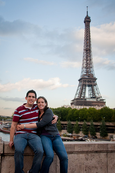 Sasha and I posing at a spot on a bridge in front of the Eiffel Tower in Paris.