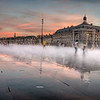 The sun is setting at the Miroir d´eau, in front of Place de la Bourse in Bordeaux, France.