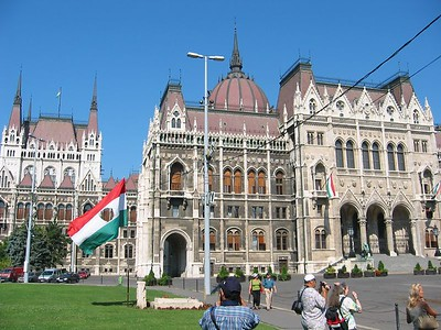 Hungarian Parliament.  The flag has a hole to symbolize when the troops tore out the Soviet coat of arms during the revolution.