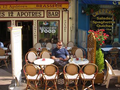Breakfast in a sidewalk cafe. Life is tough