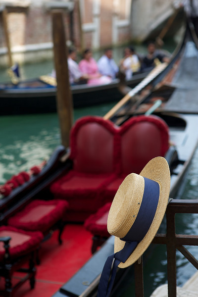Gondoleers were decked out in full uniform, and all gondolas looked clearly like gondolas.  I imagine there was some ordinances to that effect.  Here is a gondoleer's hat, and the standard red velvet interior of the gondolas.