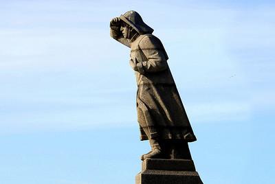 Statue  in the harbor in Amsterdam