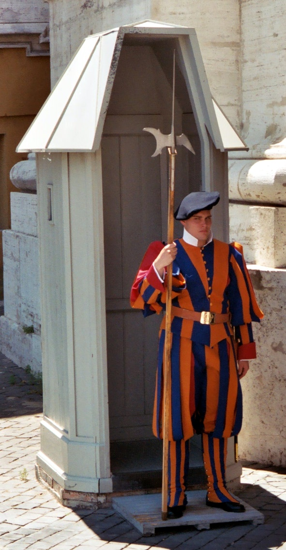 "Swiss guard, vatican city. To qualify for this job, you must be tall, athletic, ""pleasing to the eye"", swiss, multilingual and catholic. And be willing to wear anything."