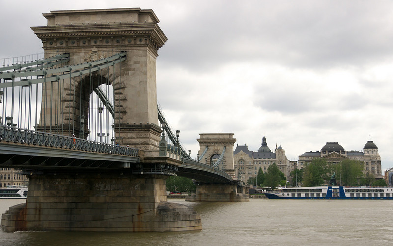The Chain Bridge was the first permanent bridge across the Danube in Budapest, and was opened in 1849. It was destroyed by the Germans in WW2 but reconstructed after the war in the same style.