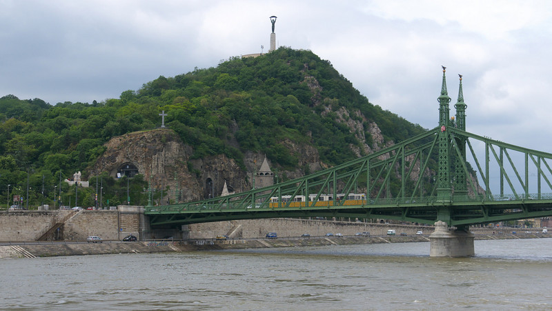 The Liberty Bridge and the Liberation Monument atop Gellert Hill. The monument  was built to commemorate the liberation of Hungary from Nazi Germany.
