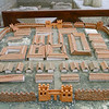A model of the city. The model itself is in rough shape. Judging by the distances to the various sites, the model is not to scale or else the baths were outside the city walls.