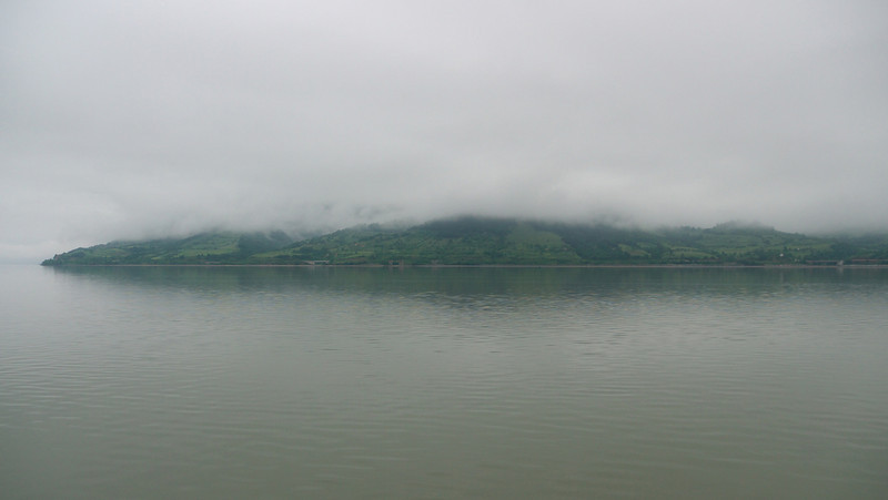A pre-breakfast stroll reveals a low hanging cloud. The ship is docked on the Serbian side and this is a view of Romania across the river.