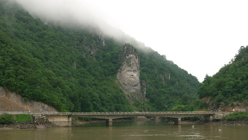 On the Romanian bank, the likeness of Trajan's Dacian opponent Decebalus watches over the Danube.