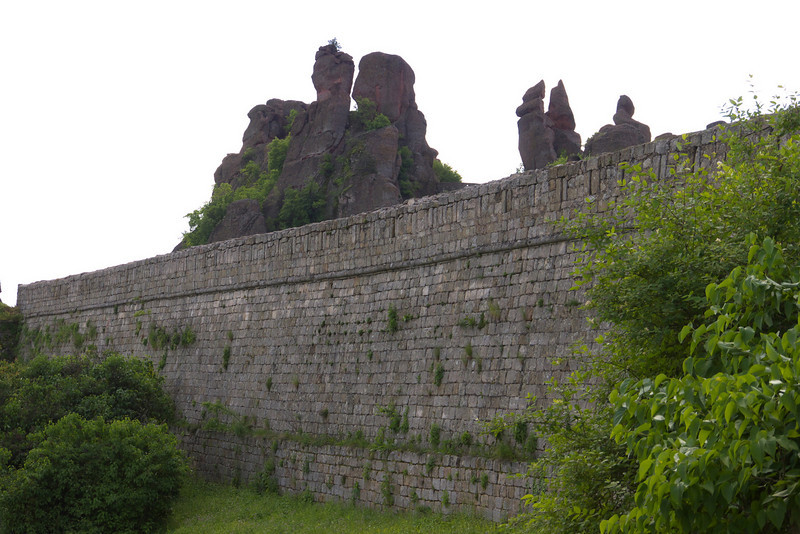 Lower walls with the natural fortifications in the background. The walls are over 2 meters thick in the foundation and reach up to 12 m in height.