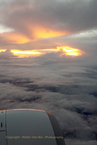 "Setting sun, during our flight ""FR3223"" to Manchester. [shot with Samsung S4]"