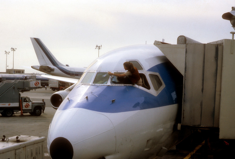 Airplane window washer