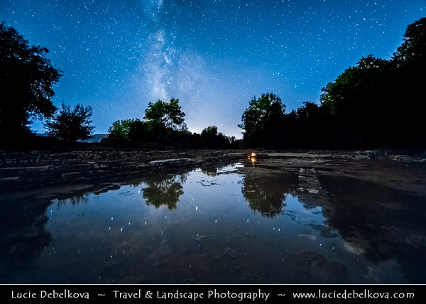Europe - Albania - Vlorë County - Butrint - Buthrotum - UNESCO World Heritage Site - Ancient Greek Ruined City & archeological site within Butrint National Park - Triconch Palace - Night sky with stars and Milky Way