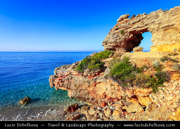 Europe - Albania - Vlorë County - Albanian Riviera - Dhërmi - Maritime village on slope of Ceraunian Mountains & coast of Adriatic & Ionian Sea, northernmost arm of Mediterranean Sea - Rocky Arch - Unusual coastal rock formation