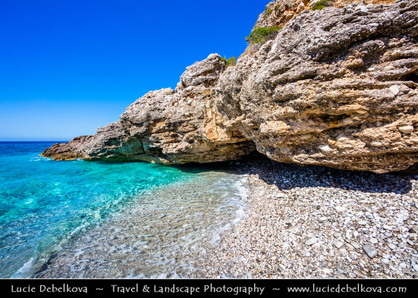 Europe - Albania - Vlorë County - Albanian Riviera - Dhërmi - Maritime village on slope of Ceraunian Mountains & coast of Adriatic & Ionian Sea, northernmost arm of Mediterranean Sea - Crystal clear waters with white sand and stones