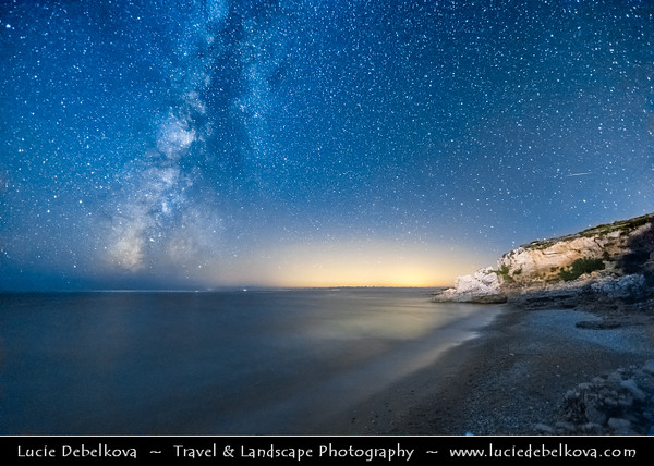 Europe - Albania - Vlorë County - Albanian Riviera - Dhërmi - Maritime village on slope of Ceraunian Mountains & coast of Adriatic & Ionian Sea, northernmost arm of Mediterranean Sea - Rocky Arch - Night sky with stars and Milky Way with Meteorite - Meteor - Falling star - Shooting star