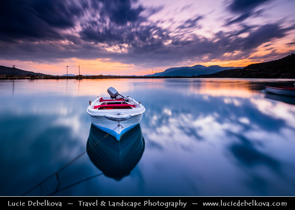 Europe - Albania - Vlorë County - Butrint - Buthrotum - Butrint National Park - Sunset over laguna with fishing boats