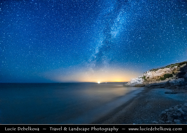 Europe - Albania - Vlorë County - Albanian Riviera - Dhërmi - Maritime village on slope of Ceraunian Mountains & coast of Adriatic & Ionian Sea, northernmost arm of Mediterranean Sea - Rocky Arch - Night sky with stars and Milky Way
