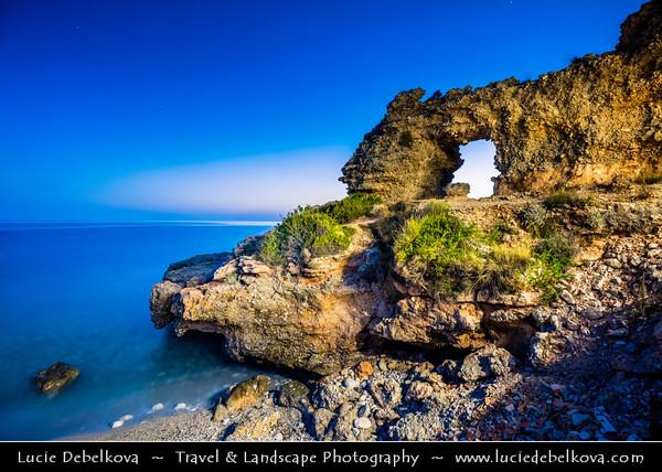 Europe - Albania - Vlorë County - Albanian Riviera - Dhërmi - Maritime village on slope of Ceraunian Mountains & coast of Adriatic & Ionian Sea, northernmost arm of Mediterranean Sea - Rocky Arch - Unusual coastal rock formation