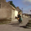 "...same cross, in ""The Quiet Man"" scene where Sean & Mary Kate escape on a tandem bicycle from their courting chaperone"