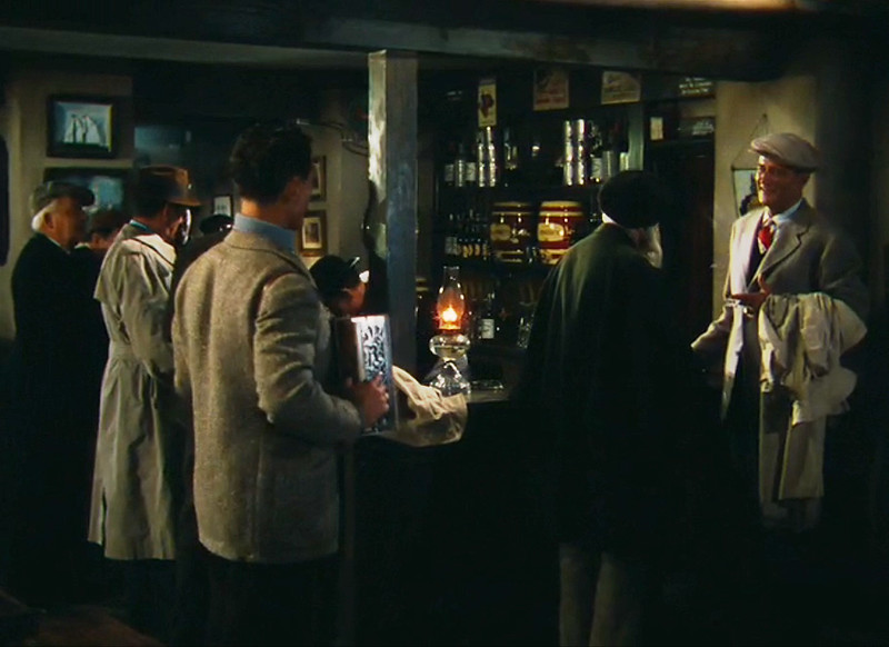 "John Wayne, far right, as Sean Thornton, in the fierst of several scenes filmed in Pat Cohan's Bar, during the movie ""The Quiet man"""