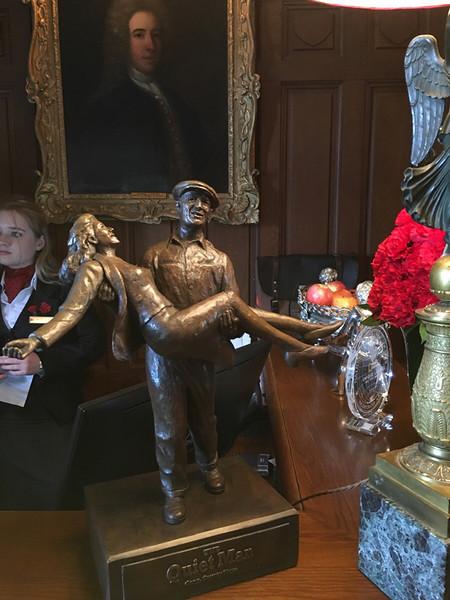 miniature Quiet Man sculpture at the castle's reception desk