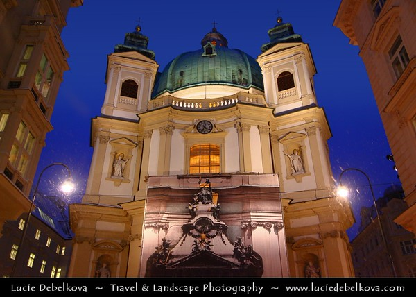 Europe - Austria - Österreich - Vienna - Wien - Peters Platz and the facade and entrance to St Peter's Church - Peterskirche - Baroque Roman Catholic parish church topped by its great turreted dome at Dusk - Twilight - Blue Hour - Night