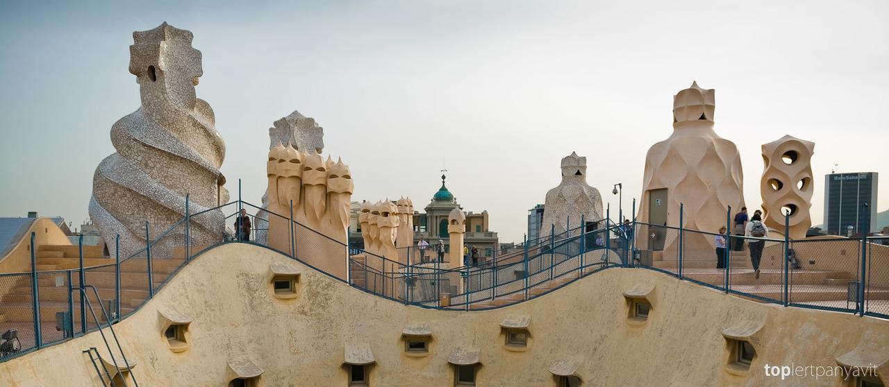 Strange sculptures stand on top of Casa Mila by Antonia Gaudi in Barcelona