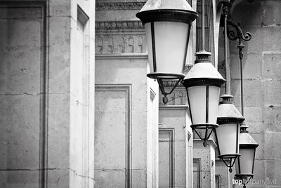 Lights hang off columns by Placa Reial in Barcelona