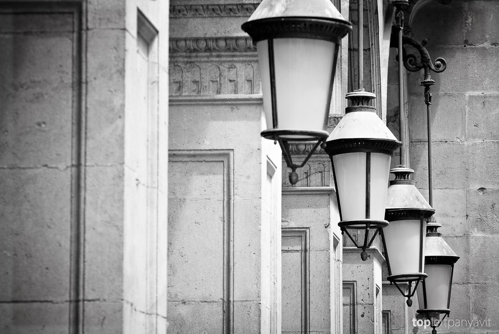 Lights hang off columns by Placa Reial in Barcelona