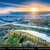 Europe - Belarus - Belorussia - Minsk - Aerial view of cityscape along Svisloch (Свислочь) River with Belarusian Great Patriotic War Museum at Sunset