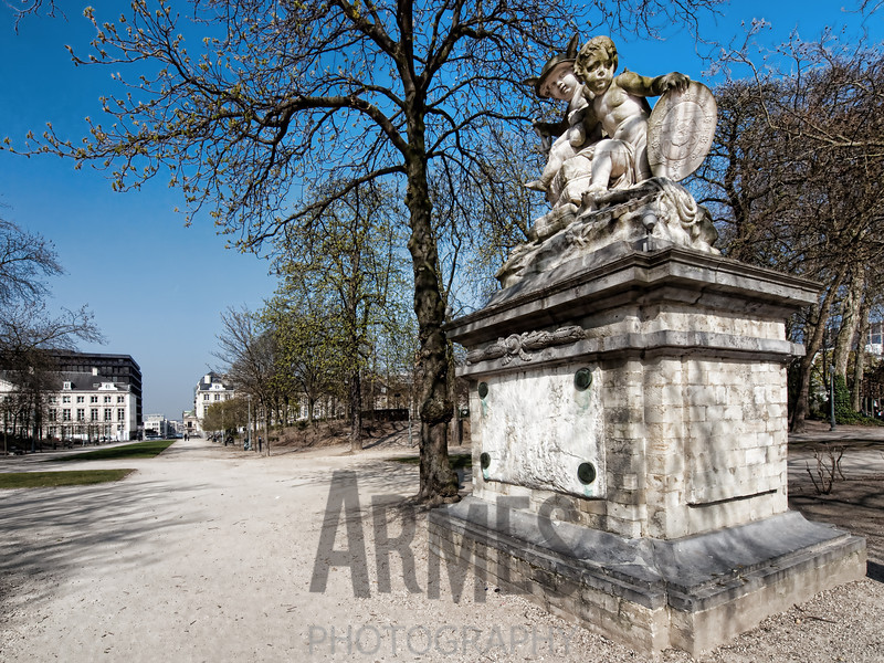 Parc de Bruxelles, Brussels, Belgium<br /> Statue of Commerce and Navigation (Godecharle Gilles Lambert, 1784): represented by two children, one wearing a winged hat holding the caduceus of Mercury, the other resting his hands on a medallion with the seal of Prince Strahemberg