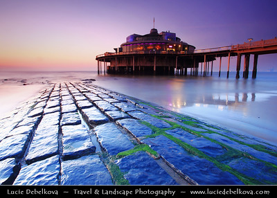 Belgium - West Flanders - Blankenberge - Flemish coastal town on shores of North Sea - National and to a certain extent international seaside resort - Blankenberge Pier reaching into the North Sea at Dusk - Twilight - Blue Hour