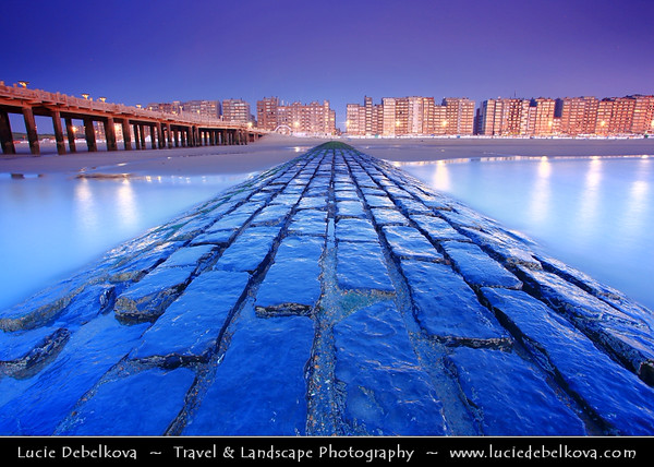 Belgium - West Flanders - Blankenberge - Flemish coastal town on shores of North Sea - National and to a certain extent international seaside resort - Blankenberge town skyline during Moon Rise at Dusk - Twilight - Blue Hour