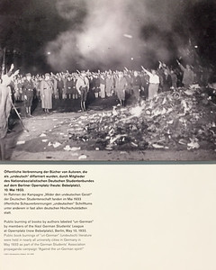 """Public burning of books by authors labeled """"un-German"""" by members of the Nazi German Students' League at Opernplatz (now Bebelplatz), Berlin, May 10, 1933."""