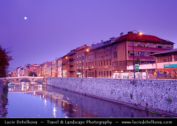 Europe - Bosnia and Herzegovina - Sarajevo - Сарајево - Capital city - Bascarsija district - Baščaršija - Cityscape along Miljacka River in the heart of historical city at Dusk - Dawn - Twilight - Blue Hour - Night