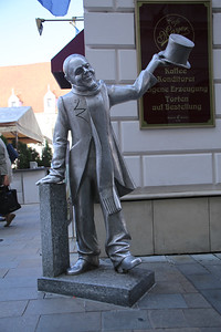 Schone Naci Statue - Schone Naci was a well known figure in the early 20th century. A poor and mentally ill man, he paraded the streets of Bratislava in old, but elegant attire - a velvet frock - and greeted passersby with his top-hat, bowing courteously to the ladies.